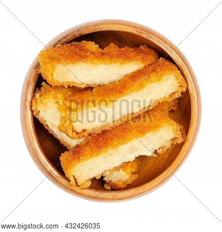 Deep-fried Vegan Schnitzel Slices, In A Wooden Bowl. Fried Cutlets, Based On Soy Protein, A Meat Sub