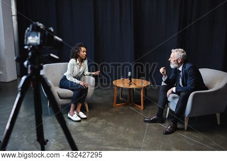 African American Journalist Talking With Guest In Interview Studio