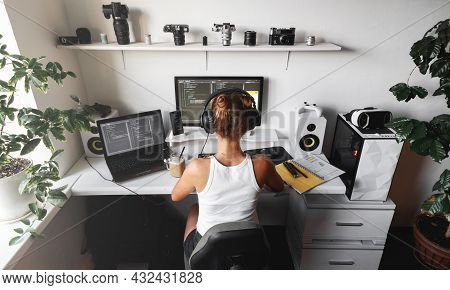 Girl Programmer In The Modern Developer Workplace For Writing Code With White Computer Desktop And C
