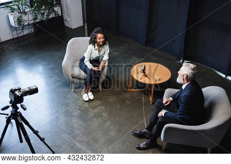 High Angle View Of Happy African American Journalist Talking With Guest In Interview Studio