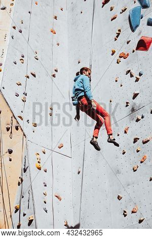 Daily Workouts. Young Man Professional Rock Climber Practicing At Training Center In Sunny Day, Outd
