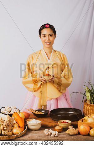 Portrait Korean Asian Beautiful Woman Wearing Golden Hanbok, Preparing Food, Folk Wisdom Korean Reci