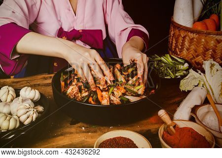 Top View Cooking Korean Pickled Kimchi, A Korean Food Dish By A Woman Wearing A Hanbok Sitting, Mixi