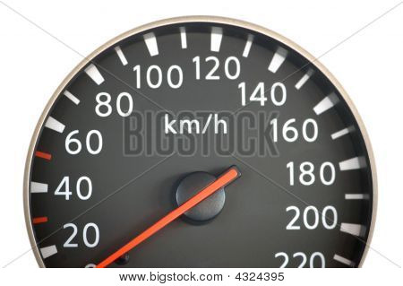 Close Up Of Car Speedometer With Red Arrow