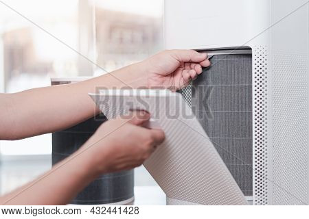 Hand Asia Man With Wear A Dust Mask Open The Lid Of The Air Purifier Check And Change Filter In Side