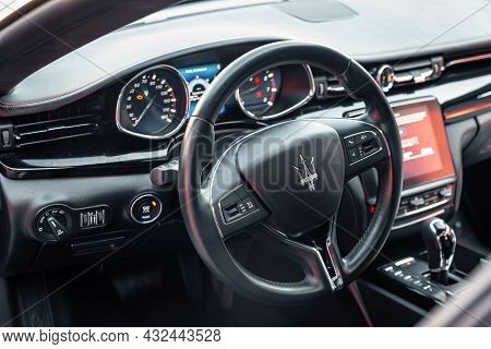 Ukraine, Odessa September 8 - 2021: Interior Of Modern Luxury Car Maserati Ghibli. Cockpit With Stee