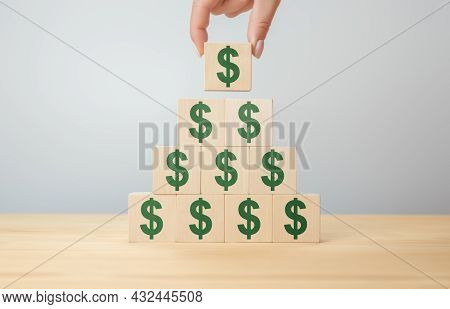 Businessman Hand Holding Wooden Blocks With The American Dollar Symbol. Money, Cash, Currency And In