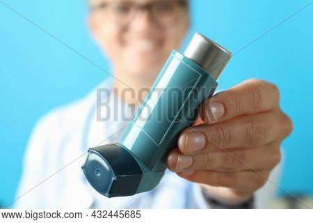 Young Doctor Woman Holds Asthma Inhaler, Close Up And Selective Focus