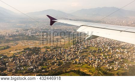 Aerial View For Kathmandu From The Airplane Porthole, The Plane Is Landing. Travel Concept