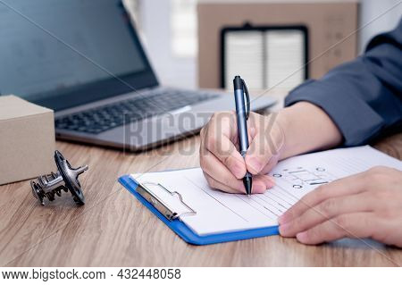Car Service Staff Write On The White Paper Clip File Board Part List And Stock Check With Car Thermo