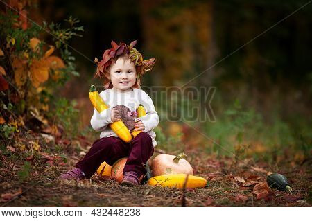 Cute Little Girl Playing With Vegetable Marrow In Autumn Park. Autumn Activities For Children. Hallo