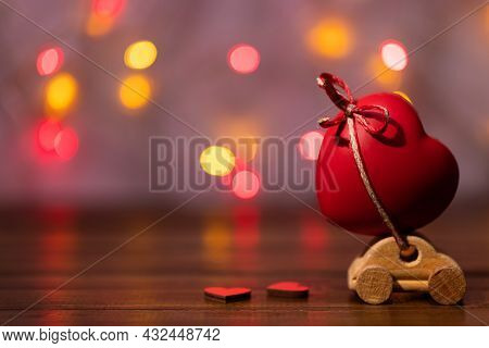 Valentine's Day Concept With Car And Heart Shape On Bokeh Background.