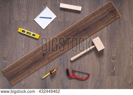 Wood laminate floor and tools background texture. Wooden laminate floor with tool