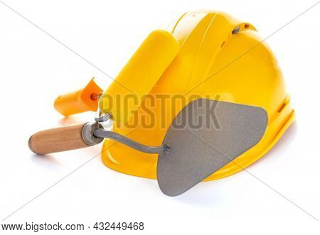Construction hard hat and trowel isolated on white background. Hardhat at white