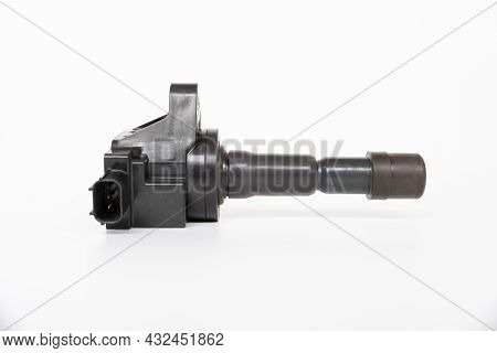 Old Ignition Coil Of Gasoline Engine White Background Service Concept And Maintenance Long Time With