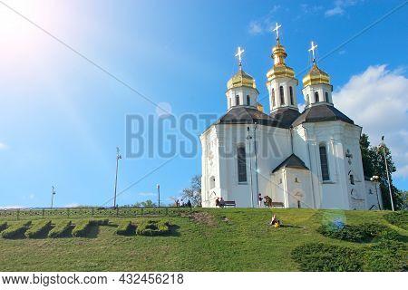 Beautiful Sunny Landscape With Old Ukrainian Orthodox Church In Sunny Rays