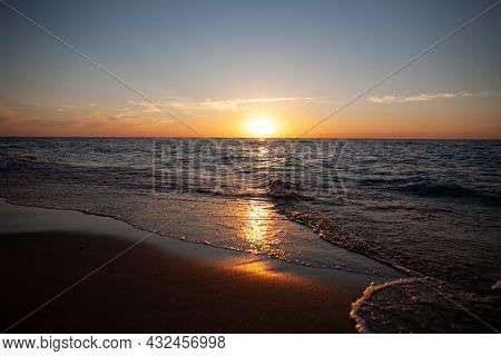 Sunset On The Beach With Sun Reflecting Off Sea Waves | Calming Photo Of Sunset Over The Sea And The