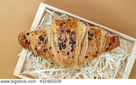One Regular Fresh Crispy Whole Grain Croissant With Chocolate Filling On A Brown Or Coffee Backgroun
