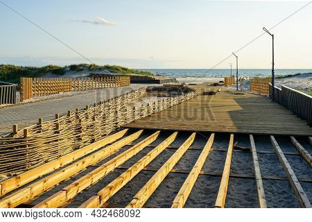 Unfinished Wooden Boardwalk For More Convenient Access To The Beach