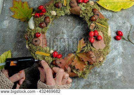 Faceless Woman Creates An Autumn Wreath From Natural Materials. Thanksgiving Day Concept.