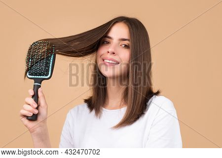 Beautiful Woman Combs Her Healthy Hair. Combing Healthy Long Straight Female Hair, Close Up. Attract