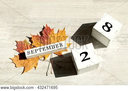 Calendar For September 28 : The Name Of The Month Of September In English, Cubes With The Number 28,