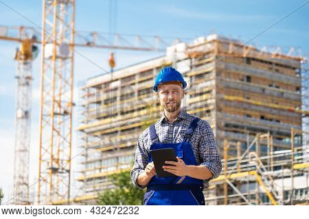 Inspection Engineer Worker At Construction Site Using Tablet