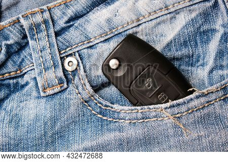 An Ignition Key For A Car, Auto In A Jeans Pocket, Car Security And Protection Concept