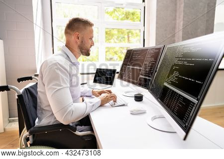 Computer Programmer Writing Program Code On Computer In Office