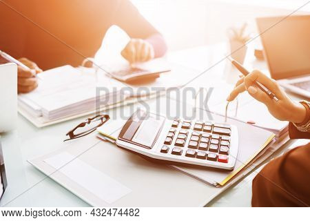 Chartered Accountants Using Calculator For Tax Invoice