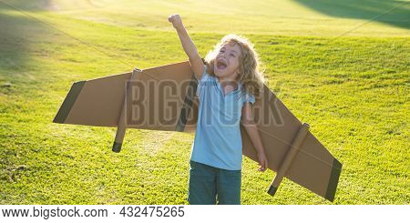 Child Playing With Toy Plane Wings In Summer Park. Innovation Technology And Success Concept. Kid Pi
