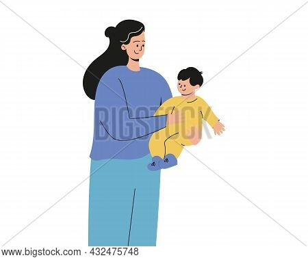 A Woman Is Holding A Small Child In Her Arms. Mother And Son, A Child In Their Arms. Mom Holds The B