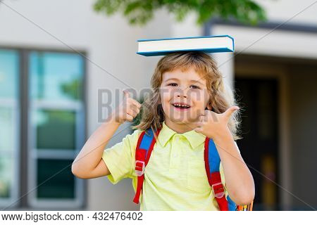 Kid Ready To School. Schoolboy Pupil With Backpack Outdoor.