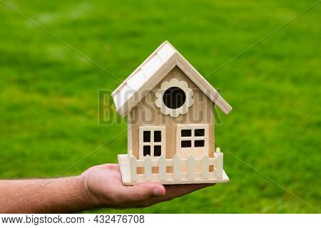 Male Hands Holding Small Miniature Toy House. Mortgage Property Insurance Dream Moving Home And Real