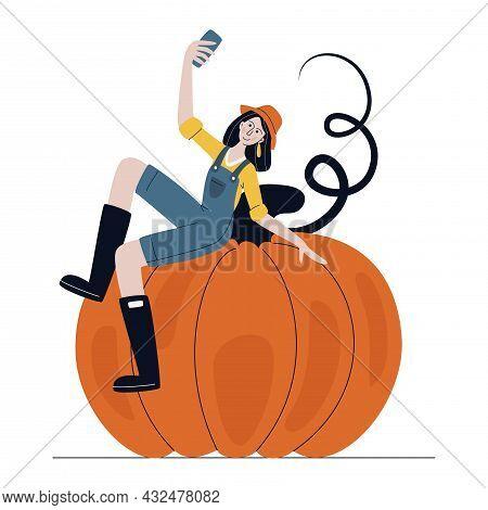 Farmer Woman In Modern Style Sitting On Huge Pumpkin And Taking Selfie On Mobile Phone. Harvesting,