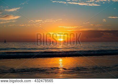 Sunset At The Sea. Sunrise At Beach. Colorful Ocean Beach Sunrise.