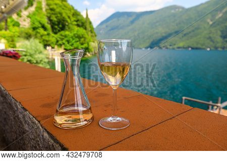 Rose Wine By The Lakefront Of Lugano City In Switzerland. Romantic Appetizer In Ticino Canton On Swi
