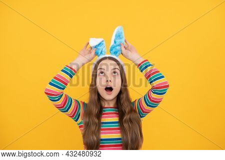 Surprised Easter Child Girl In Rabbit Bunny Ears Smiling On Holiday, Happy Easter