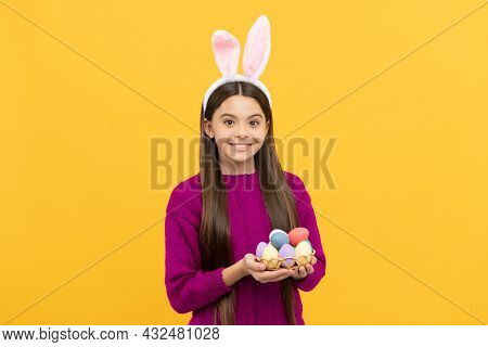 Childhood Happiness. Child In Rabbit Costume Hold Painted Eggs. Time For Egg Hunt.