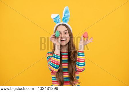 Happy Easter. Childhood Happiness. Child In Rabbit Ears Hold Painted Eggs. Time For Fun.