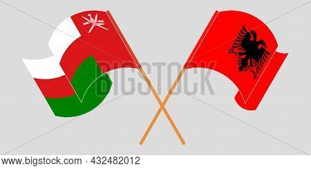 Crossed And Waving Flags Of Albania And Oman