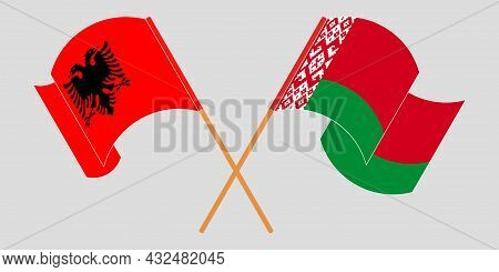 Crossed And Waving Flags Of Albania And Belarus