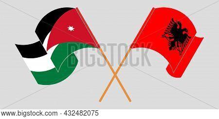 Crossed And Waving Flags Of Albania And Jordan