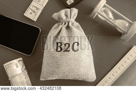 Money Bag With The Word B2c. Business-to-consumer. Commercial Relationship Between The Organization