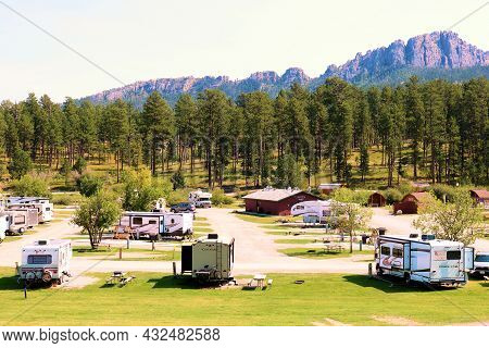 September 8, 2021 In Hill City, Sd:  Rv Campers On Assigned Camp Sites Surrounded By An Alpine Conif