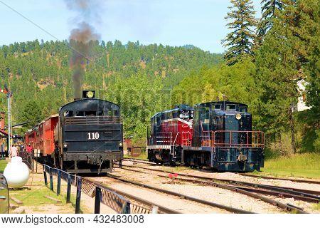 September 8, 2021 In Hill City, Sd:  Vintage Steam Locomotive Hauling Passenger Rail Cars Taken At T
