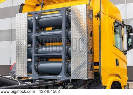 Compressed Natural Gas Cylinders Behind The Truck Cab. Truck With A Methane Engine. Cng As A Fuel. G