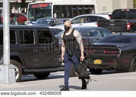 Bronx, New York, Usa - May 20, 2020: Muscular And Tattooed Man Wearing Mask Against Covid-19.