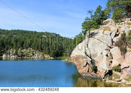 Granite Rocks Bluffs Overlooking An Alpine Lake Taken At A Pine Forest In Horse Theif Lake, Sd Withi