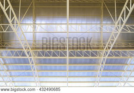 Low Angle View Of Metal Roof Structure With Heat Insulations Inside Of Industrial Building Construct